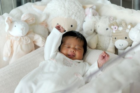 Rapper Ray J and wife Princess Love pose with their one-week old baby girl Melody