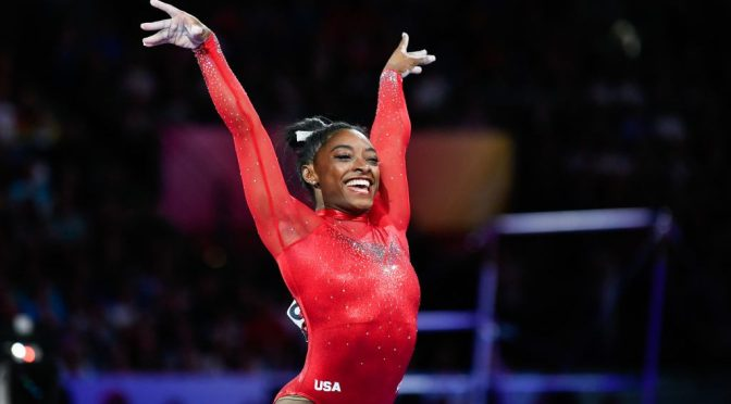 WATCH the most decorated female gymnast #SimoneBiles' floor routine as her boyfriend cheers on! [Vid]
